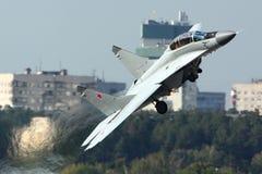 Mikoyan Gurevich MiG-35 av ryssflygvapen som visas på 100 år årsdag av ryska flygvapen i Zhukovsky Royaltyfria Foton