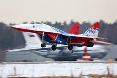 Mikoyan Gurevich MiG-29 of Swifts aerobatics team taking off at Kubinka air force base. Kubinka, Moscow Region, Russia - June 19, 2015: Mikoyan Gurevich MiG-29 Stock Photo