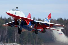 Mikoyan Gurevich MiG-29UB 11 BLUE jet fighter of Strizhi The Swifts aerobatics team taking off at Kubinka air force base. Stock Photography