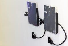 Mikro przekształtnika wyposażenie dla elektrycznej zmiany bezpośredni prąd dla energii słonecznej przemysłowej na biel ścianie z  obrazy royalty free