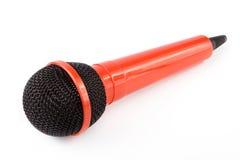 mikrofon över röd white Arkivbilder