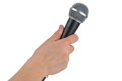 Mikrofon i hand på en vit bakgrund Arkivfoton