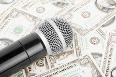 Mikrofon i pieniądze obrazy royalty free