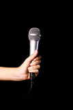 Mikrofon lokalisiert auf schwarzem baground Lizenzfreie Stockfotografie