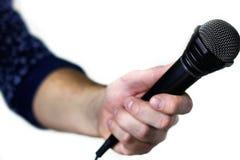 Mikrofon na sceny ręki chwycie Zdjęcia Stock