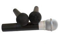 Mikrofon tre på vit bakgrund royaltyfria bilder