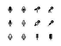 Mikrofonikonen auf weißem Hintergrund. Stockfotos