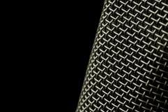 Mikrofonineinander greifen Stockfoto