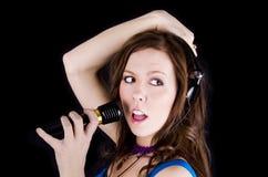 mikrofonkvinnabarn Arkivfoto