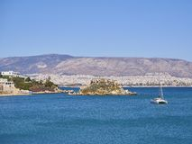 Mikrolimano bay and Nisos Koumoudourou island. Attica, Greece. stock image