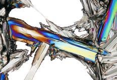 Mikroskopisk sikt av kristallen för kaliumnitrat i polariserat ljus Arkivfoton