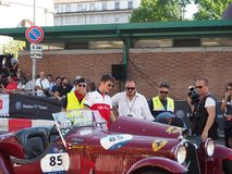 Milão, Itália - 29 de agosto de 2018: Charles Leclerc que fala sobre seu carro histórico fotografia de stock royalty free