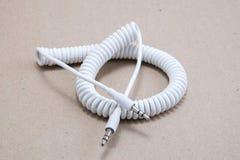 3 5 milímetros del enchufe de cable del espiral Fotografía de archivo