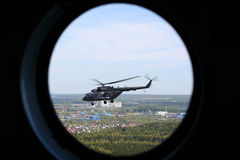 Mil Mi-8AMTSH helicopter of Russian Air Force seen from window during Victory Day parade. MOSCOW REGION, RUSSIA - MAY 9, 2015: Mil Mi-8AMTSH helicopter of Stock Photo