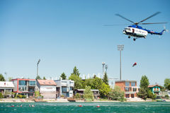 Mil Mi-17 helicopter conducting a rescue from the water on Senec Sunny Lakes, Slovakia. SENEC, SLOVAKIA - MAY 28: Dynamic display of Mil Mi-17 helicopter stock photo
