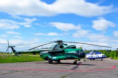 Mil Mi-8 helicopters of Spark Avia Airline Company and Special Aviation Department of the Ministry of Interior of Russia. Saint Petersburg, Russia - May 23,2015 Stock Photos