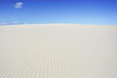 Mil och mil av sand på mörk punkt Arkivbilder