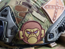 Mil-Spec Monkey and confederate flag patches on a tactical bulle. Los Angeles, CA, USA - March 17, 2016: Mil-Spec Monkey and confederate flag patches on a Stock Image