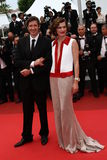 Mila Jovovitch and Paul W. S. Anderson. CANNES, FRANCE - MAY 18: Mila Jovovitch and Paul W. S. Anderson attend the 'La Conquete' premiere during 64th Annual stock photography