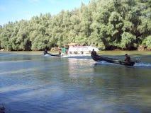 Fishing boats on Danube River, Romania stock photo