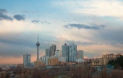 Milad Tower among High Rise Building in the Skyline of Tehran. Skyline of Tehran with Milad Tower among high rise buildings royalty free stock images