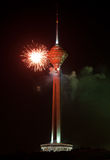Milad Tower Illuminated with Red Firework against Black Sky Stock Photos