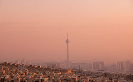 Milad Tower in the Skyline of Tehran at Pink Sunset Royalty Free Stock Images