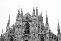 Milan. Famous Duomo cathedral dating back to the 13th century with gothic spires - in black and white Stock Image