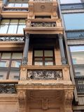 Milan Apartment Balconies, Lombardy, Italy. A multi level apartment building in Milan, Lombardy, Italy, with small rectangular cast iron and stone balconies Stock Photography
