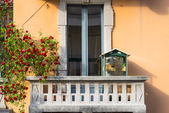 Milan, balcony with birds and roses Stock Photo
