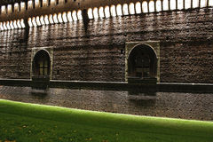 The milan castle at night walls Stock Images