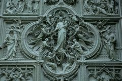 Milan Duomo Cathedral doorway. Close-up of the door of the Milan Cathedral royalty free stock image
