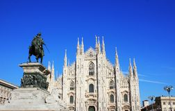 Milan Cathedral or Duomo di Milano and monument to Victor Emmanuel II in Milan, Italy.  Stock Photos
