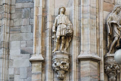 Milan cathedral Duomo,Dome,david with goliath head. Milan Cathedral (Duomo di Milano) is the cathedral church of Milan in Lombardy, northern Italy. It is the Stock Images