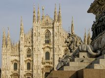Milan Cathedral - Duomo, with lion Equestrian statue of Vittorio Emanuele I in the foreground.  Royalty Free Stock Photography