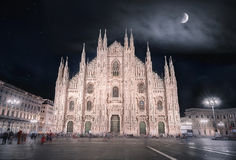 Milan Cathedral  at night. Night picture with the Cathedral of Milan, known also as the Duomo of Milan, with a beautiful sky full of stars and enlightened by the Royalty Free Stock Images