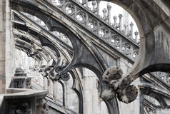 Milan cathedral roof gothic ornaments spire pointed archs statues Stock Photo