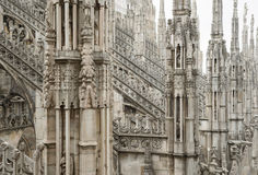 Milan cathedral roof gothic ornaments spire pointed archs statues Royalty Free Stock Images