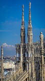 Milan Cathedral Spires under blue sky Stock Image