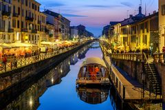 Milan city, Italy, Naviglo Grande canal in the late evening. Milan city, Italy, Naviglo Grande canal is a popular illuminated in the late evening stock images