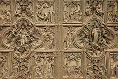 Milan - detail from gate of Dom Stock Photos