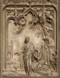 Milan - detail from gate -  Jesus and Magdalene Stock Image