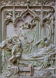 Milan - The detail from main bronze gate of the Cathedral -  birth of Virgin Mary by Ludovico Pogliaghi, 1906 Royalty Free Stock Photos