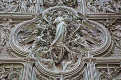 Milan - The detail from main bronze gate of the Cathedral -   Virgin Mary with the angels by Ludovico Pogliaghi, 1906. Stock Images