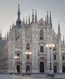 Milan Dome. Night shot of the dome, duomo, in Milan, Italy, with three street lights in front of the enormous cathedral Royalty Free Stock Images