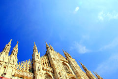 Milan Duomo on blue sky Stock Photos