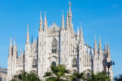 Milan Duomo cathedral with palm trees, blue sky Stock Images