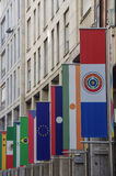 Milan - Expo flags in Vittorio Emanuele Avenue Stock Photography