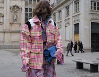 MILAN - FEBRUARY 25, 2018:Fashion blogger CANDELA PELIZZA posing for photographers in SAN FEDELE square before MSGM fashion show,. Fashion blogger CANDELA royalty free stock photos