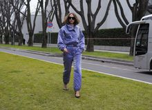 MILAN - FEBRUARY 25, 2018: Fashion blogger CANDELA PELIZZA posing for photographers in the street before Armani fashion show, duri. Fashion blogger CANDELA royalty free stock photo